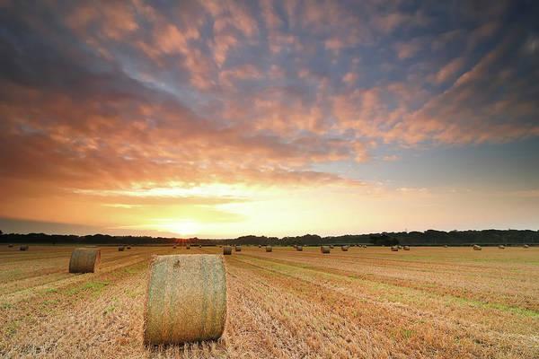Horizontal Art Print featuring the photograph Hay Bale Field At Sunrise by Stu Meech