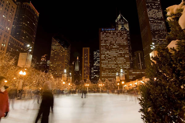 Ice Rink Art Print featuring the photograph Ice Skaters And Chicago Skyline by Sven Brogren