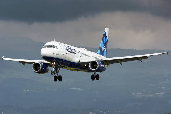 Jetblue Airways Airbus A320 Landing San Jose Costa Rica Mroc Sjo Aviation Airplane Landing Art Print featuring the photograph jetBlue A320 landing with mountain by Andres Meneses