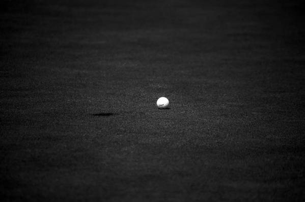 Golf Ball Hole Grass Black White Tee Golfball Art Print featuring the photograph Just Shy by William Haney