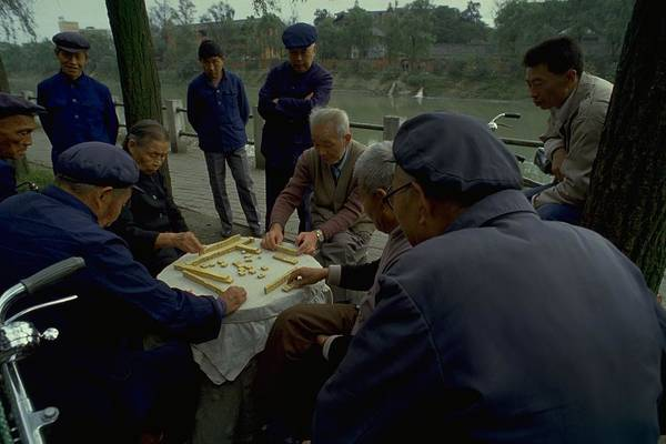 Mahjong In Guangzhou China Street Scene Group Of Old People Mao Suit Play Playing By The River Player Game With A Tile On Chinese Character And Hat To Hand An Age Tradition Photo Open Air Crowd Onlooker Pose Travel Picture Look Face Clothing Dark Blue Zhongshan Tunic Or Symbolism Pocket Front Virtue Polite Famous Michel Guntern Travelnotes Er Pics Travelpics Asia Men Lady Small Gathering Table Feature Concentration Smiling Tree Green Landscape Cycle Bike Bicycle Local Real Life Cultural Cap Male Art Print featuring the photograph Mahjong In Guangzhou by Travel Pics