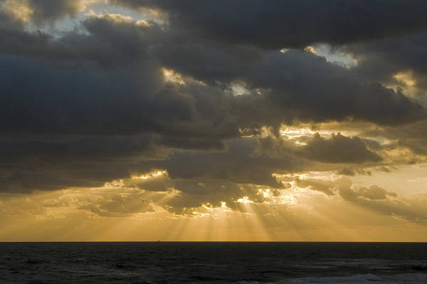 Ocean Sunset Sun Cloud Clouds Ray Rays Beam Beams Bright Wave Waves Water Sea Beach Golden Nature Art Print featuring the photograph New Beginning by Andrei Shliakhau