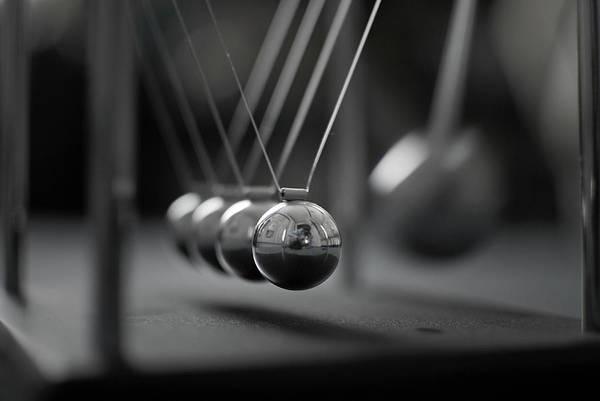 Horizontal Art Print featuring the photograph Newton's Cradle In Motion - Metallic Balls by N.J. Simrick