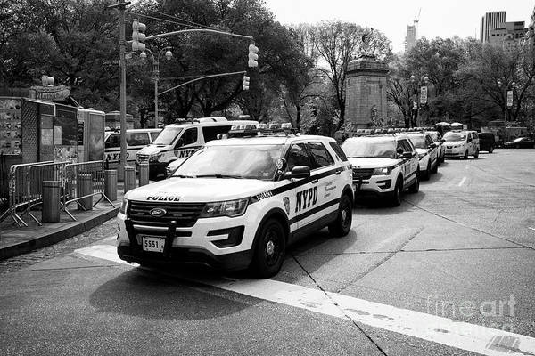 Police Art Print featuring the photograph nypd police patrol vehicles parked at columbus circle New York City USA by Joe Fox