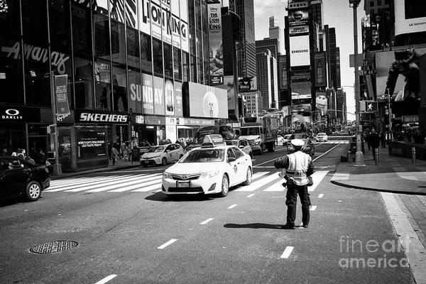 Times Square Art Print featuring the photograph nypd traffic cop on Times Square New York City USA by Joe Fox