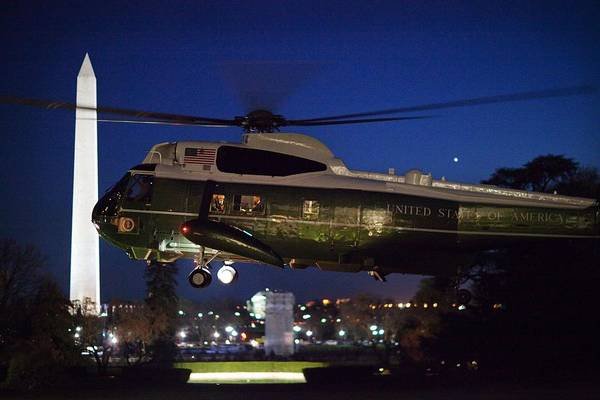 History Print featuring the photograph President Obama Reading As Marine One by Everett