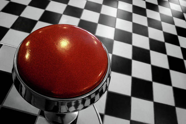 Horizontal Art Print featuring the photograph Red Cushion Stool Above Chequered Floor by Peter Young