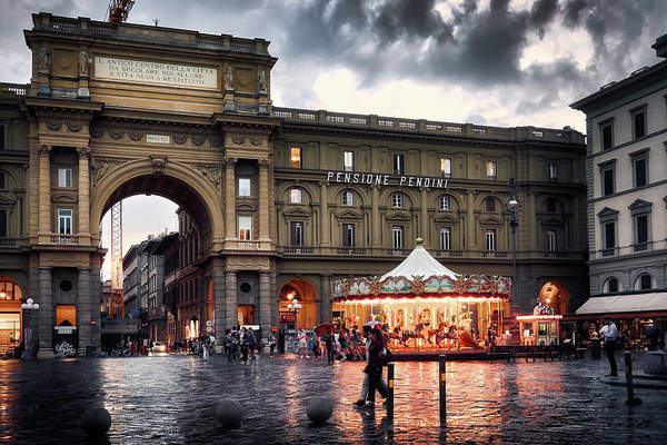 Arch and carousel at the Republic Square on a rainy day in Florence