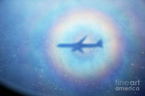 Aeroplane Art Print featuring the photograph Shadow Of An Aeroplane Surrounded By A Rainbow Halo by Sami Sarkis