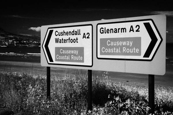 Sign Art Print featuring the photograph Signposts For The Causeway Coastal Route At Carnlough Between Cushendall And Glenarm County Antrim by Joe Fox