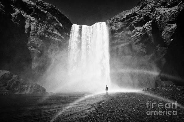 Skogafoss Art Print featuring the photograph Single Tourist At Skogafoss Waterfall In Iceland by Joe Fox