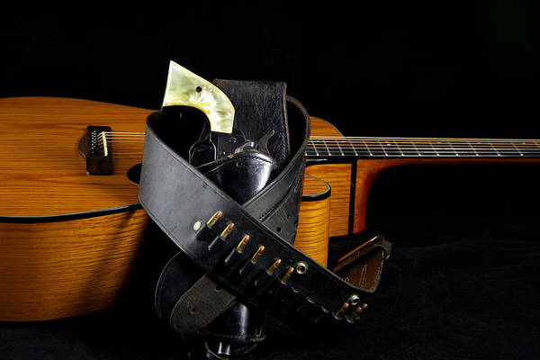 Guitar Art Print featuring the photograph Six Gun And Guitar On Black by M K Miller