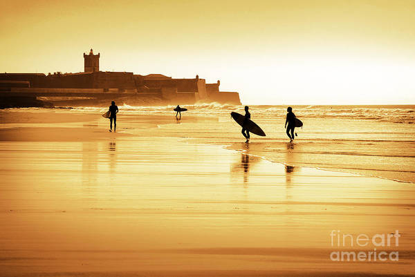 Action Print featuring the photograph Surfers Silhouettes by Carlos Caetano