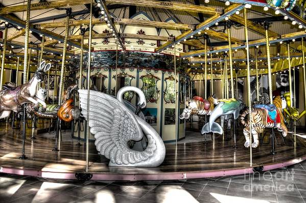 Carousel Art Print featuring the photograph Swan Seat At The Carousel by Michael Garyet