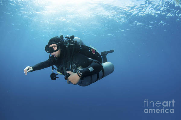 Diver Art Print featuring the photograph Technical Diver With Equipment Swimming by Karen Doody