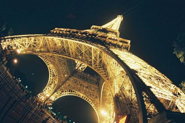 Eiffel Tower Art Print featuring the photograph The Eiffel Tower By Night by Alex Kantor