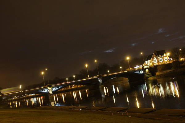 A Night Time View Of Trent Bridge In Nottingham Art Print featuring the photograph Trent Bridge by Gillian Lovett