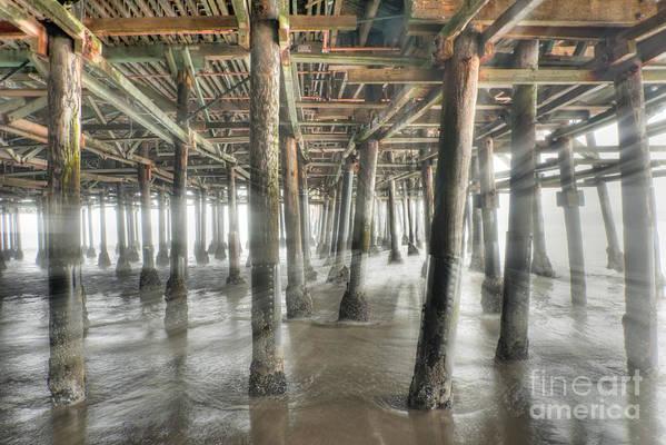 Under The Boardwalk Art Print featuring the photograph Under The Boardwalk Into The Light by David Zanzinger