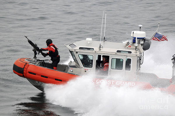 Patrol Print featuring the photograph U.s. Coast Guardsmen Aboard A Security by Stocktrek Images