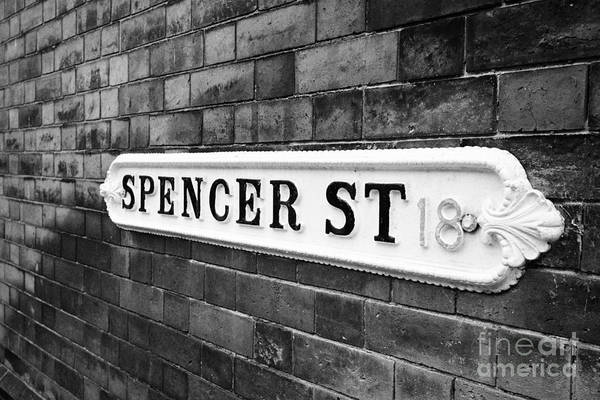 Victorian Art Print featuring the photograph victorian metal street sign for spencer street on red brick building in the jewellery quarter Birmin by Joe Fox