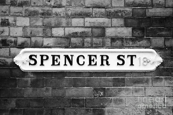 Victorian Art Print featuring the photograph Victorian Metal Street Sign For Spencer Street On Red Brick Building In The Jewellery Quarter by Joe Fox