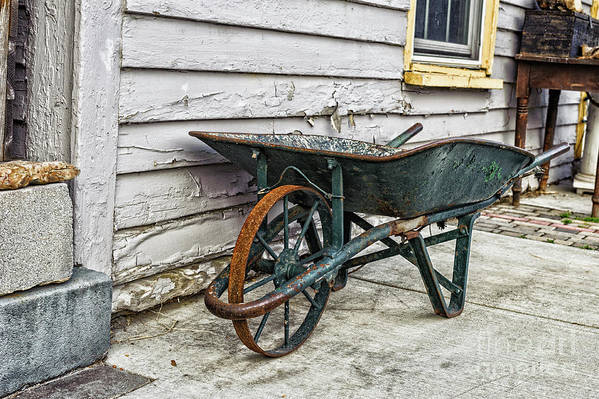 Orange Art Print featuring the photograph Weathered Green Wheelbarrow by Mary Raderstorf