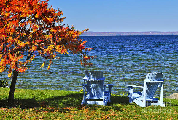 Lake Art Print featuring the photograph Wooden Chairs On Autumn Lake by Elena Elisseeva