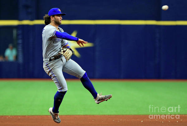 People Art Print featuring the photograph Toronto Blue Jays V Tampa Bay Rays by Mike Ehrmann