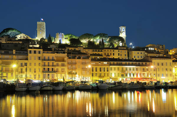 Water's Edge Art Print featuring the photograph Cannes At Night by Nikitje