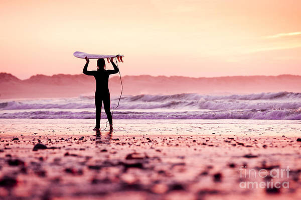 Sunrise Art Print featuring the photograph Female Surfer On The Beach At The Sunset by Iko