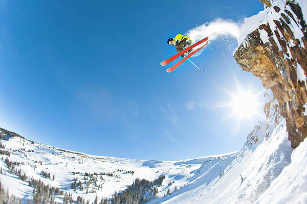 Scenics Art Print featuring the photograph Freestyle Skier Jumping Off Cliff by Tyler Stableford