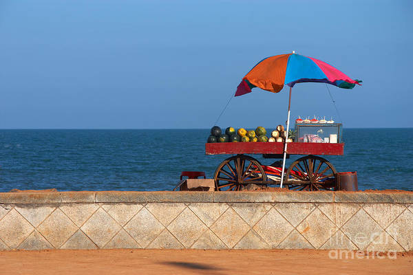 Shop Art Print featuring the photograph Seafront View Of Vendors Cart With by Polryaz