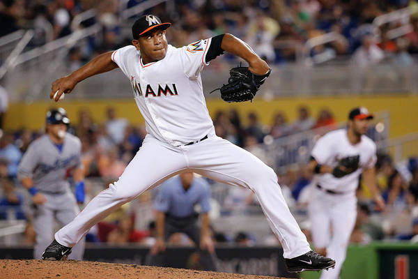 Baseball Pitcher Art Print featuring the photograph Carlos Marmol by Rob Foldy