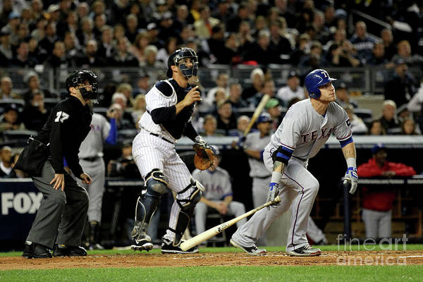 Playoffs Art Print featuring the photograph Josh Hamilton And Jorge Posada by Al Bello