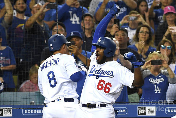 Three Quarter Length Art Print featuring the photograph Manny Machado And Yasiel Puig by Jayne Kamin-oncea