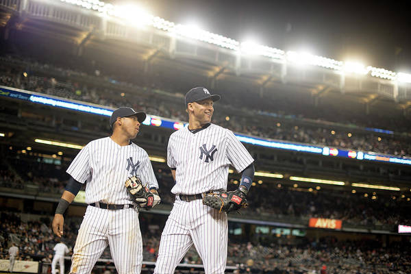 American League Baseball Art Print featuring the photograph Yangervis Solarte And Derek Jeter by Rob Tringali