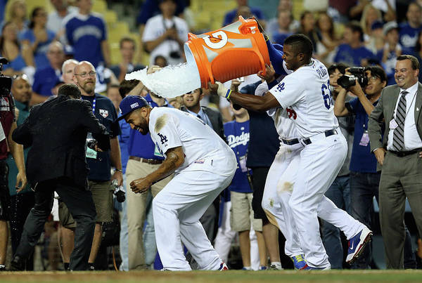 Game Two Art Print featuring the photograph Yasiel Puig And Matt Kemp by Stephen Dunn