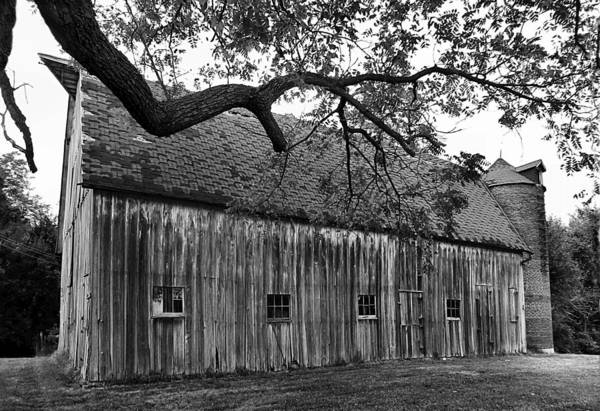 Old Barns Art Print featuring the photograph Barn With Brick Silo In Black And White by Julie Dant