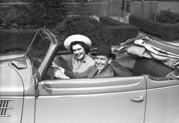 30-34 Years Art Print featuring the photograph Couple Riding In Old Fashion Convertible Car, (b&w),, Portrait by George Marks