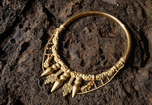 Celtic Necklace Print featuring the photograph View Of A Golden Celtic Necklace During Excavation by Volker Steger