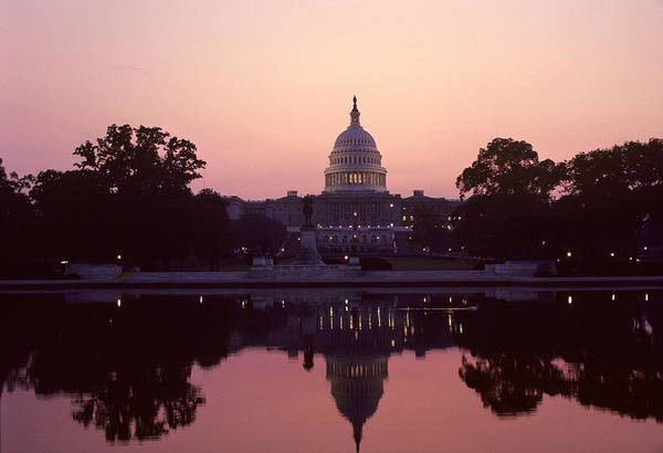 Capitol Building Print featuring the photograph The U.s. Capitol Building Reflected by Kenneth Garrett