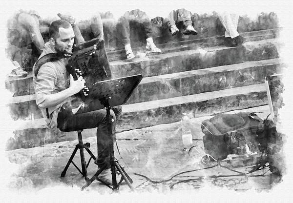 Street artist playing bandoneon at Piazza della Signoria