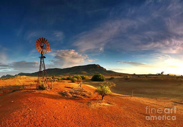 First Light Early Morning Windmill Dam Rawnsley Bluff Wilpena Pound Flinders Ranges South Australia Australian Landscape Landscapes Outback Red Earth Blue Sky Dry Arid Harsh Art Print featuring the photograph First Light On Wilpena Pound by Bill Robinson