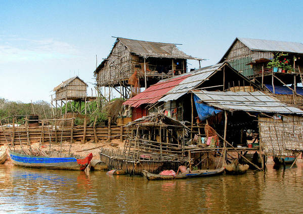 Bamboo Huts Art Print featuring the photograph On The Shores Of Tonle Sap by Douglas J Fisher