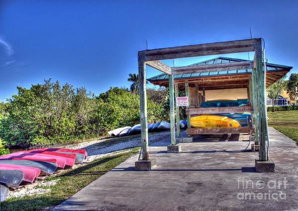Storing The Canoes Art Print featuring the photograph Storing The Canoes by Ines Bolasini