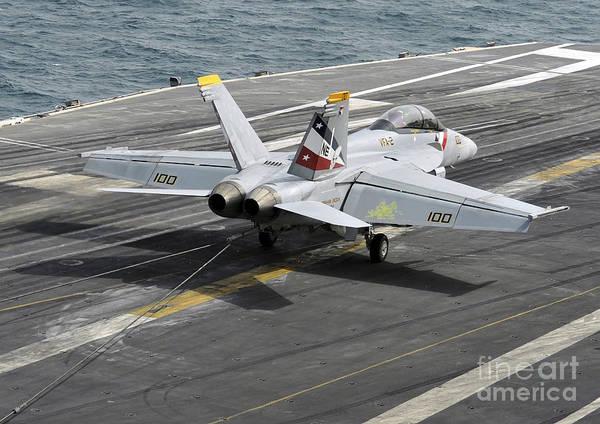 Us Navy Art Print featuring the photograph An Fa-18f Super Hornet Traps An by Stocktrek Images