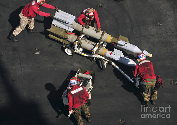 Marines Art Print featuring the photograph Marines Push Pordnance Into Place by Stocktrek Images