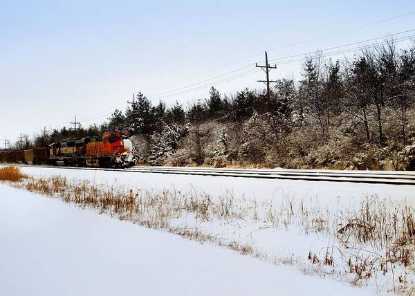 Landscape Art Print featuring the photograph A Freight Train On A Snowy Day by Tom Druin