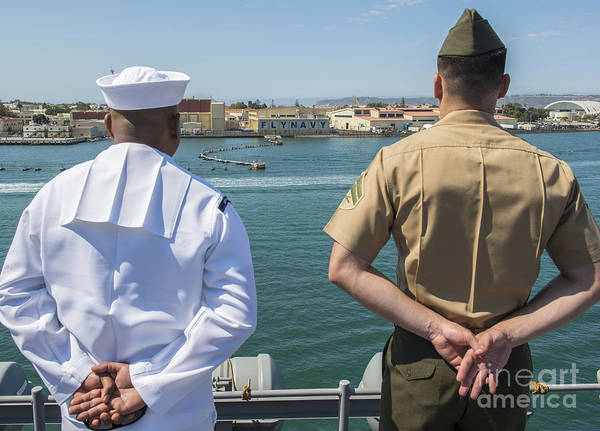 Uss Boxer Art Print featuring the photograph A Sailor And Marine Man The Rails by Stocktrek Images