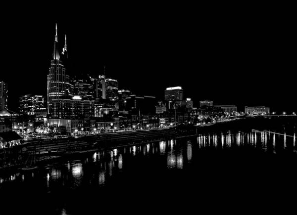 Nashville Skyline At Night In Black And White Art Print featuring the photograph Nashville Skyline At Night In Black And White by Dan Sproul